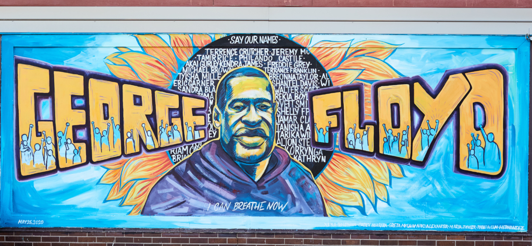 Photograph of a mural remembering George Floyd and other black American victims of police violence.
