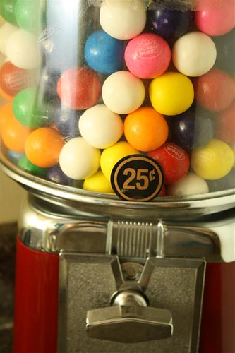 Photograph of a gumball machine.