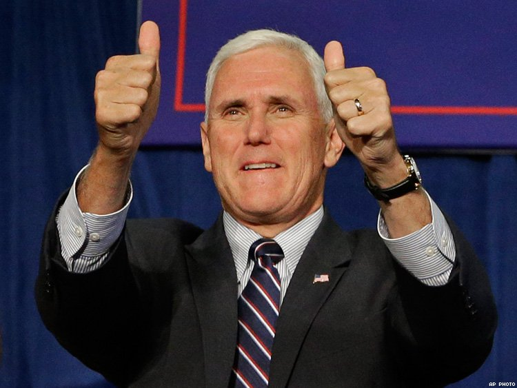 A photograph of United States Vice President Mike Pence smiling and flashing a double thumbs-up gesture.