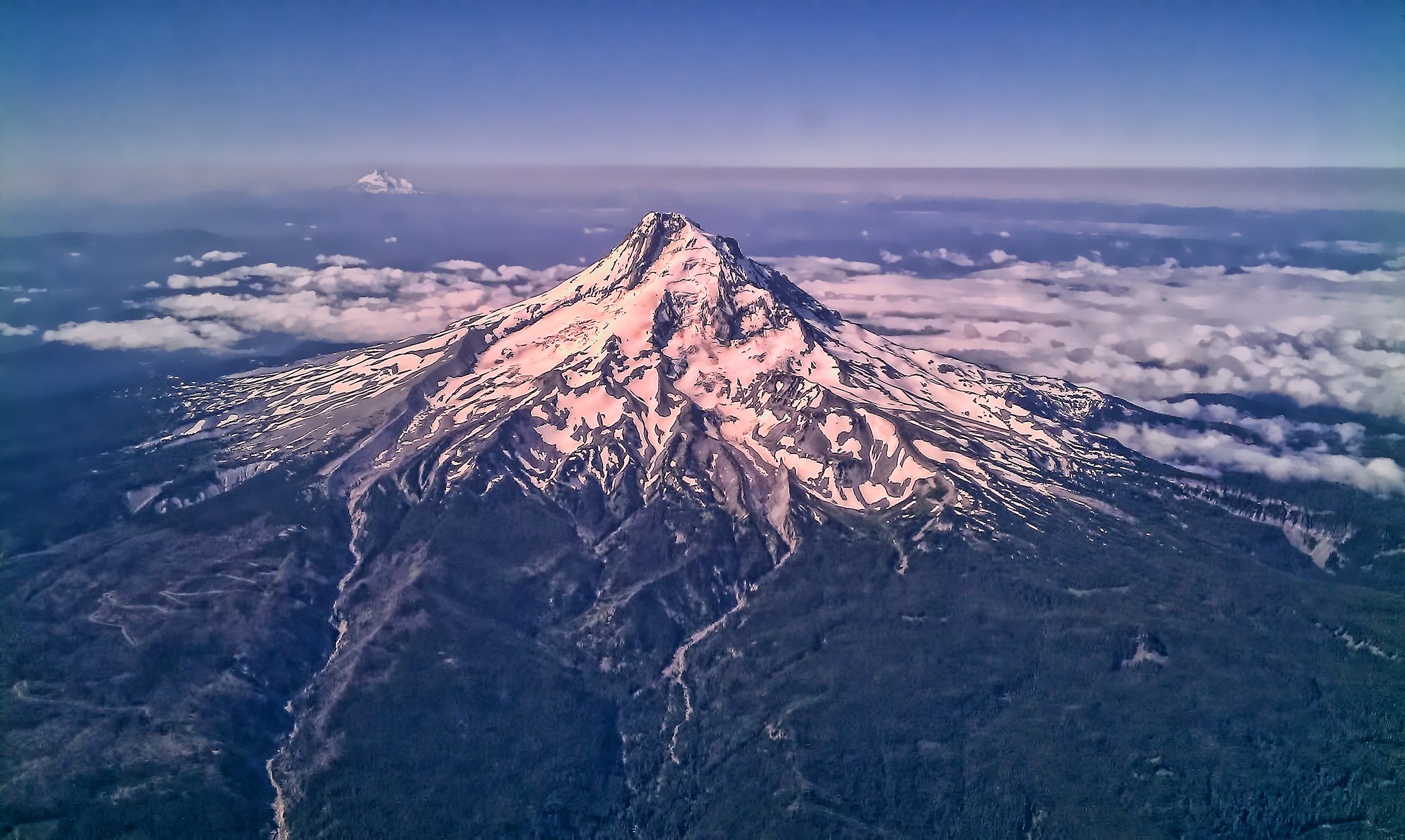 An aerial photograph of snow-capped Mount Hood near Portland, Oregon.