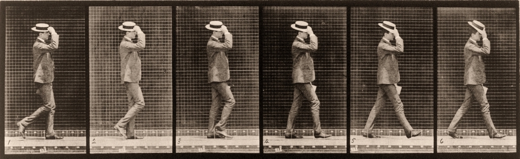 A sequential series of 19th century photographs of a man walking while tipping his straw hat.