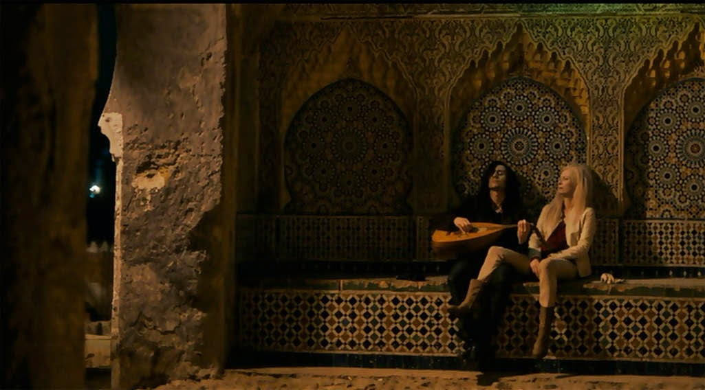 Hiddleston and Swinton as the vampires named Adam and Eve, chilling in a Tangiers alleyway.
