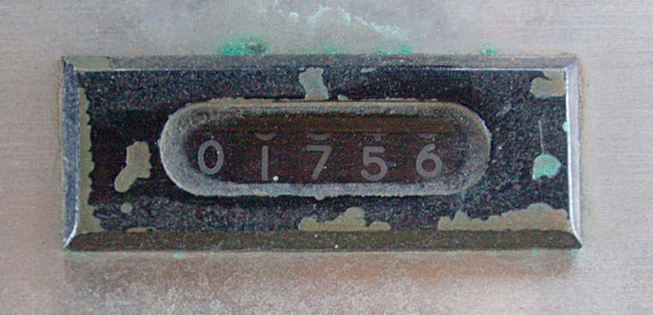 Photograph of an analog-dial traffic-counter, as found on an old turnstile